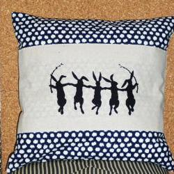 Decorative pillow cover with navy blue cotton with white ikat style polka dots and dancing rabbit screen print